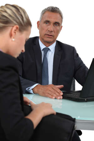 Businessman staring at an attractive woman photo