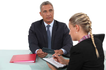 Business professionals arranging a meeting time Stock Photo - 15124793