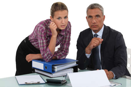 younger: Businessman working with his assistant Stock Photo