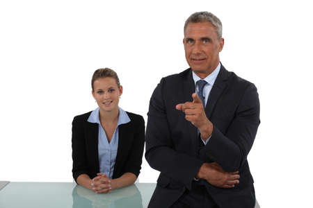 Senior businessman pointing at camera Stock Photo - 15488122