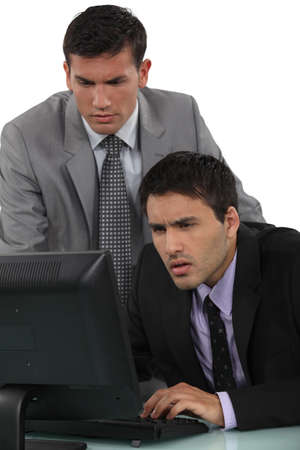 two visions: Puzzled businessmen with a laptop