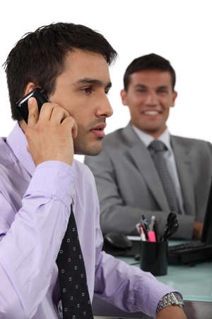 impede: Typical day at the office Stock Photo