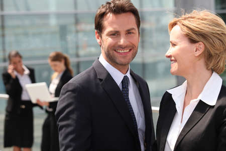 blond brown: Businesswoman looking at businessman