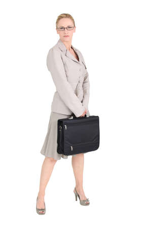 no heels: Woman in a skirt suit with a briefcase Stock Photo