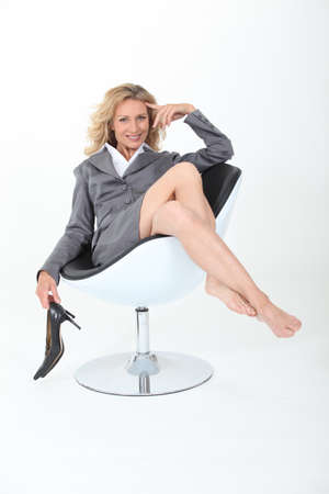 relaxed businesswoman in chair photo