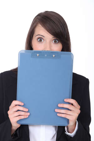 confound: Surprised woman with an office clipboard