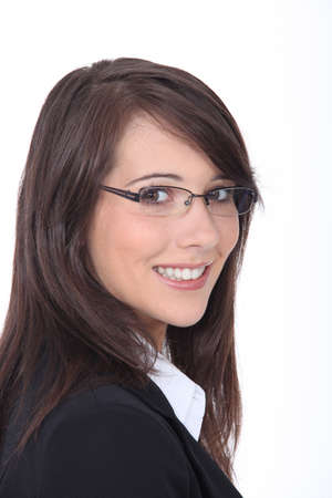 Studio shot of a smiling young woman wearing glasses Stock Photo - 15119213
