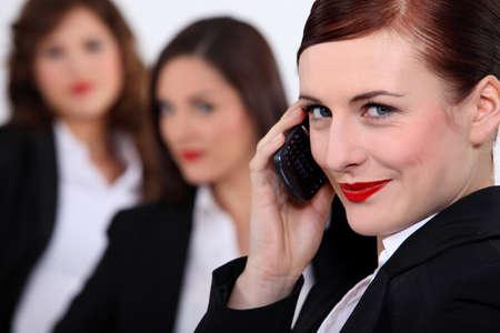 collaborators: Three businesswomen stood together