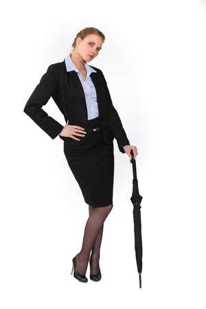 bitch: Austere businesswoman holding an umbrella