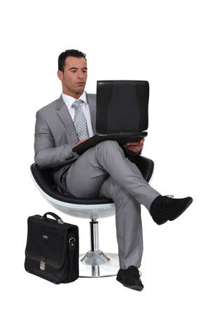 Businessman using a laptop Stock Photo - 15118542