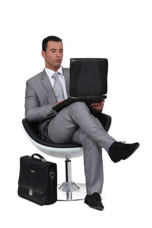 sneer: Businessman using a laptop