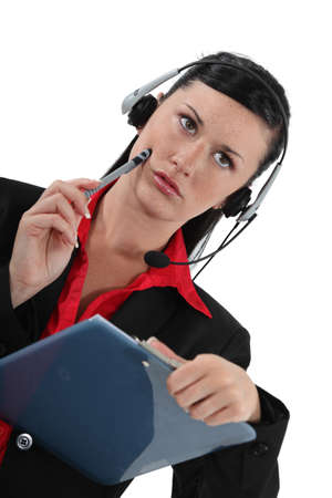 Serious woman wearing a telephone headset photo