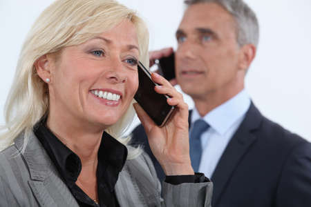 saleswoman: Middle-aged business partners Stock Photo