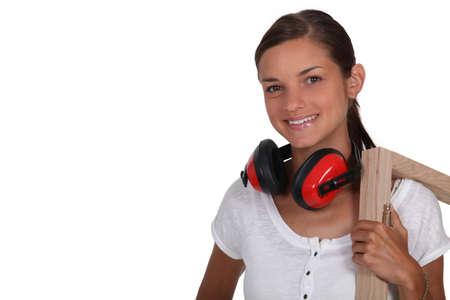 ear protection: Girl holding frame Stock Photo