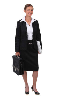 Studio shot of smiling woman in a suit with a briefcase photo