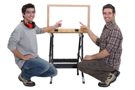 all smiles: duo of carpenters all smiles Stock Photo