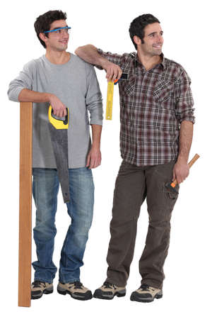 tradesmen: Tradesmen being distracted by an attractive woman Stock Photo