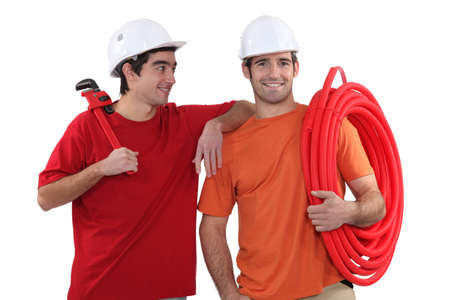 Two plumber friends Stock Photo