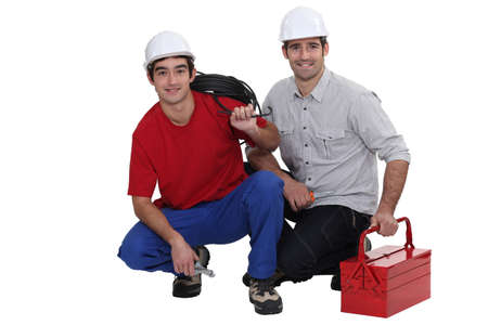 fused: Two electricians crouching down