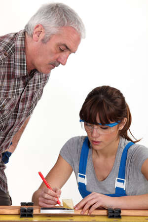 tradespeople: Man supervising his assistants work