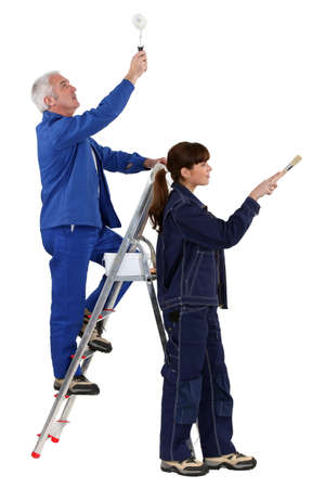 paintbucket: Father and daughter refurbishing home Stock Photo