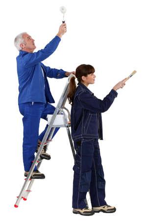 refurbishing: Father and daughter refurbishing home Stock Photo