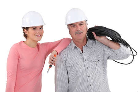 Father and daughter with electrical cable photo