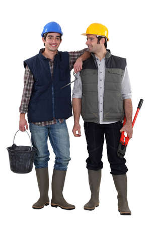 chums: Two construction workers stood together Stock Photo