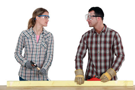 Carpenters making eye contact Stock Photo - 15119522