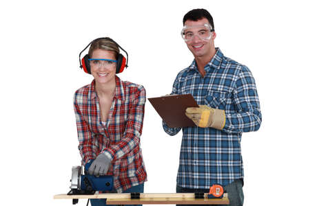 woodworking: craftsman and craftswoman working together