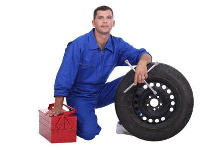 recompense: mechanic changing a tire Stock Photo