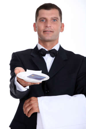 Waiter holding tray with credit card photo