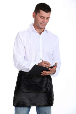 Male waiter taking order photo