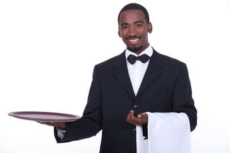 excellent customer service: well dressed black waiter