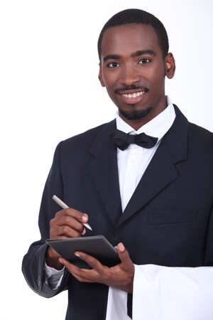 Waiter taking an order photo