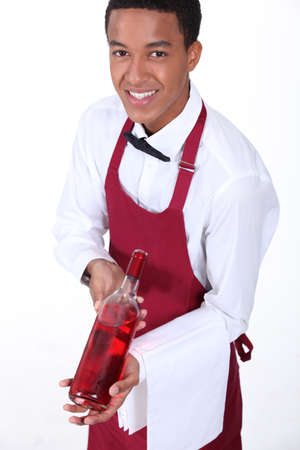 Waiter presenting bottle of wine photo