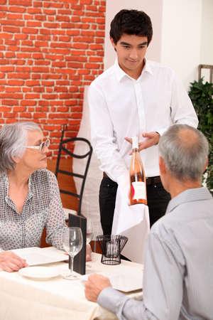 retired couple in restaurant celebrating anniversary photo