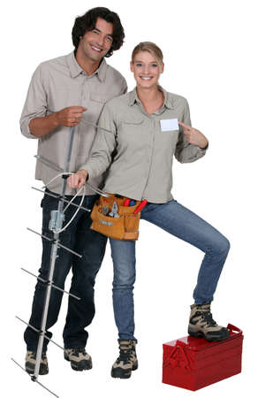 Repairers with antenna on white background photo