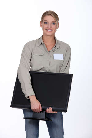 it technician: Woman delivering computer monitor Stock Photo