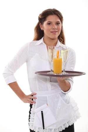 Waitress with a drinks tray Stock Photo - 15119609