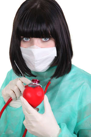 latex glove: Surgeon listening to a hearts heartbeat
