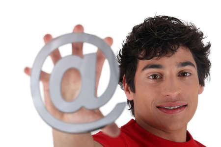 arobase: Man showing at sign