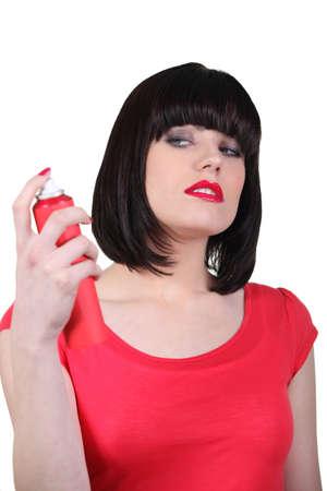 hairspray: Woman spraying hairspray Stock Photo