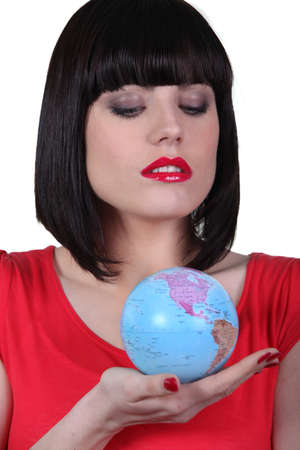 woman holding the globe in her hand photo