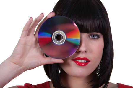 compact disk: woman holding a compact disk