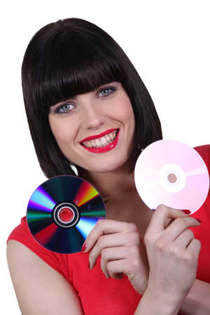 Woman with two CDs photo