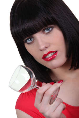 despondency: Brunette woman with glass in hand Stock Photo