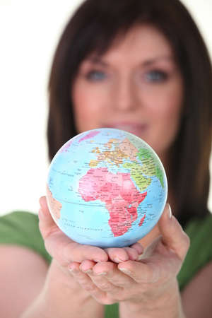 evoke: Woman with globe in hand