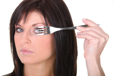 suggest: Woman with a fork