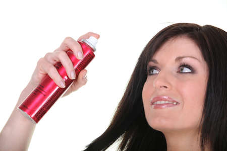 hairspray: Woman with a canister of hairspray